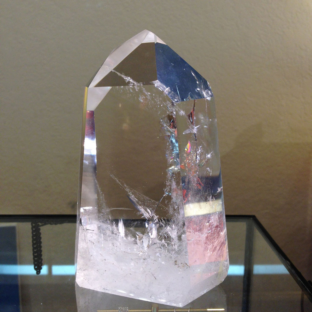 rainbows and spangles revealed within our large quartz crystal