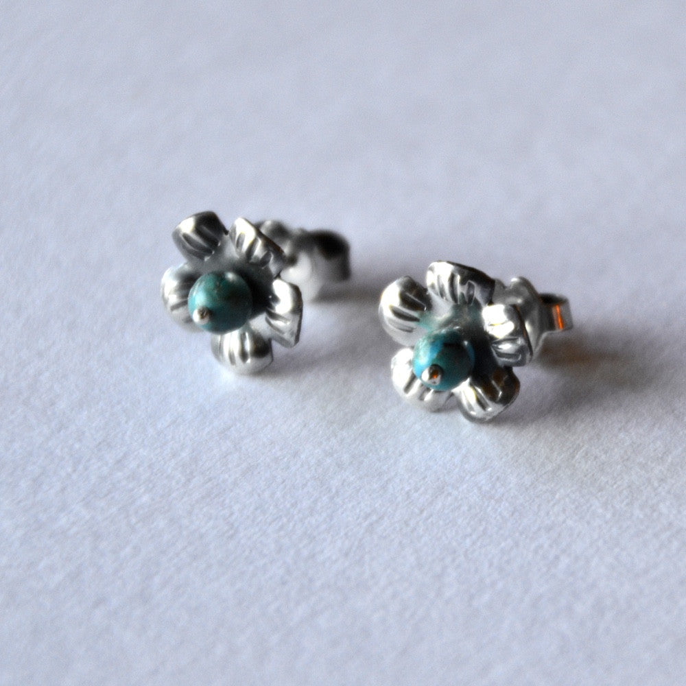 dots of turquoise nestled in sterling flowers