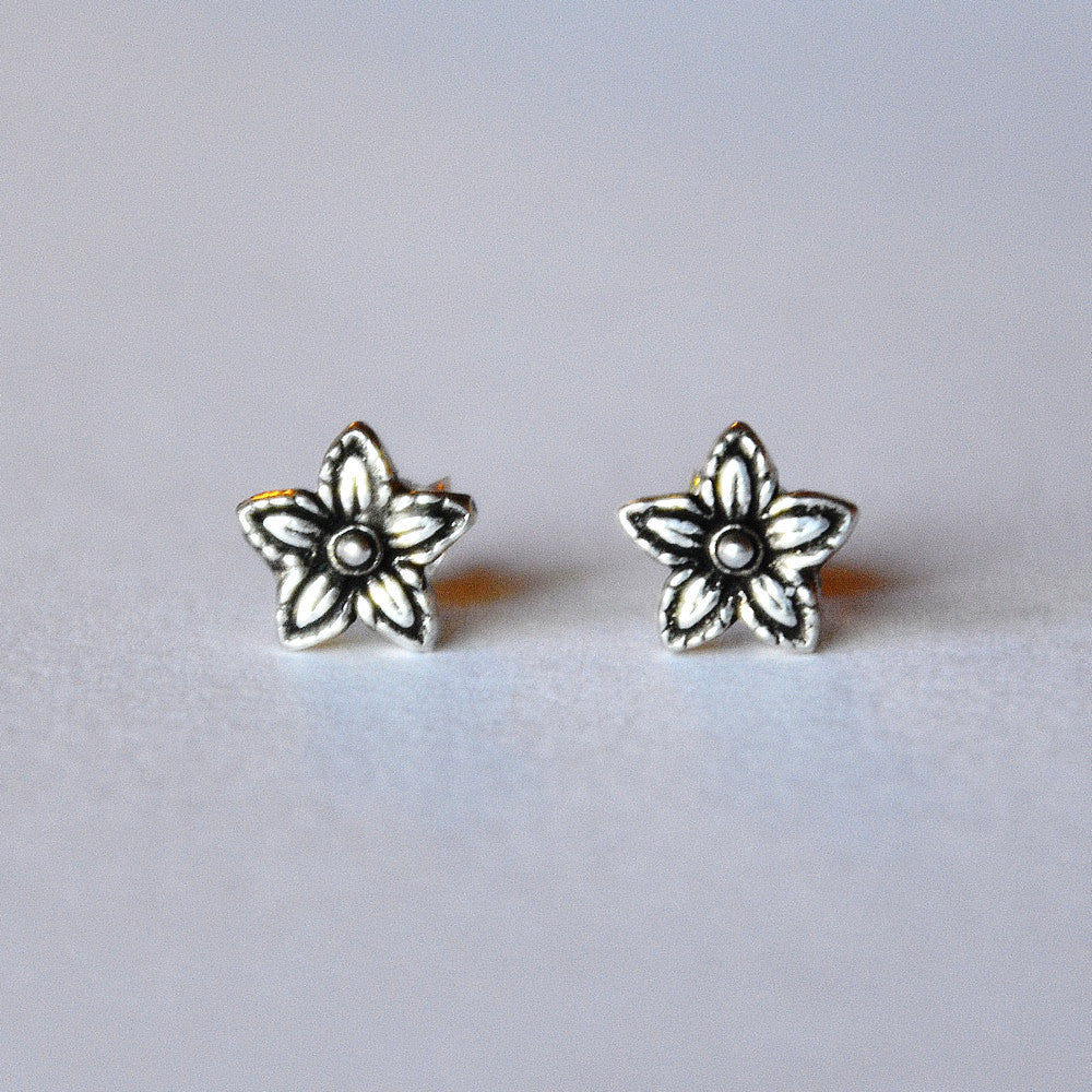 silver flower earrings with patina darkened etched details