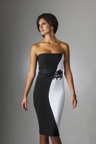 This is a strapless black and white cocktail dress with flower belt