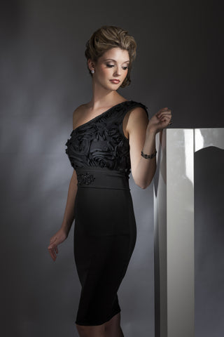 This is a one shoulder black cocktail dress with a ruffled top and belt with beaded applique