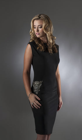This is a black cocktail dress with cap sleeves and a beaded applique on the hip