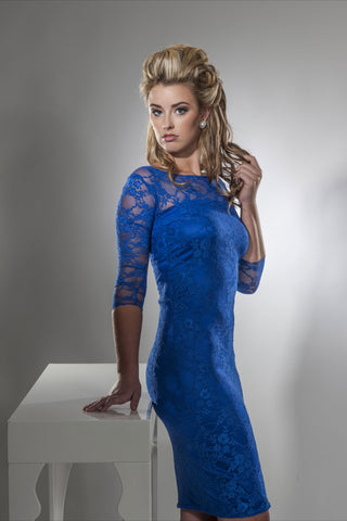 This is a blue lace 3/4 length sleeve boat neck cocktail dress with stretch silk charmeuse under the lace