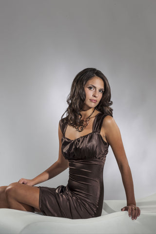 This is a brown stretch satin cocktail dress with rouched straps and a sweetheart neckline