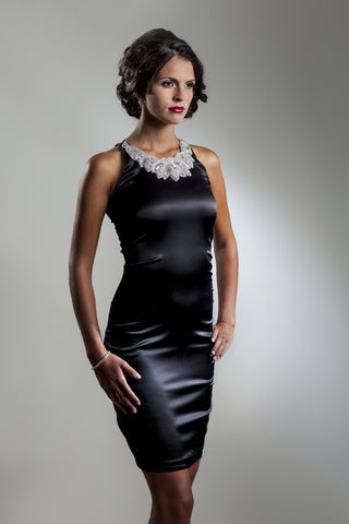 This is a sleeveless black stretch silk charmeuse cocktail dress with silver beaded neck applique