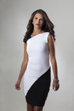 This is a black and white color block cocktail dress