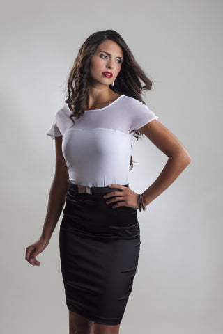 This is a short sleeve black and white cocktail dress with a white chiffon top and a black stretch silk skirt