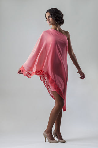 This is a light pink coral one shoulder chiffon cocktail dress with a lace edging