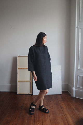 shauna wearing hayley oversized black linen dress with deep pockets and black sandals