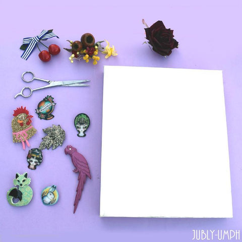 DIY brooch board out of a canvas, material and hot glue gun