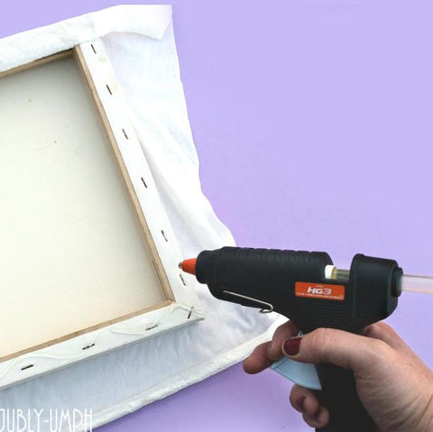 Glue your fabric to the back of your canvas frame- Pin/brooch/hair flower display board DIY