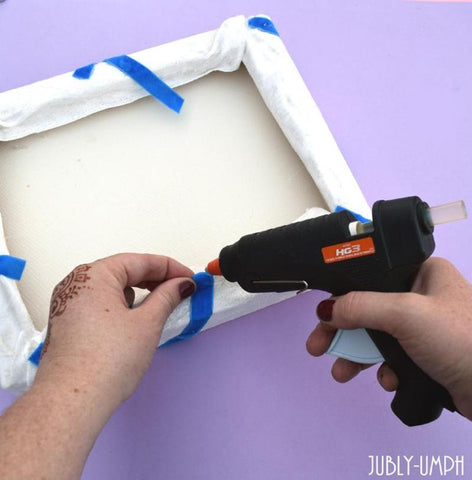 Glue the ribbon to the back of the board with the hot glue gun- Make this fun DIY brooch board on the Jubly-Umph blog