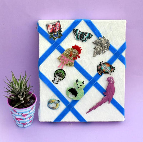 The finished display board with lots of lovely quirky brooches on it. Learn how to make this on the Jubly-Umph blog