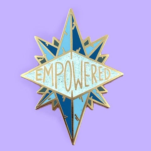 Blue enamel lapel pin with the word 'empowered' emblazoned across it.