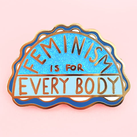 enamel pin with the phrase- feminism is for everybody on it