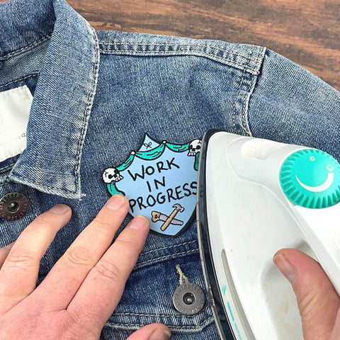ironing on a Jubly-Umph embroidered patch