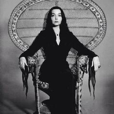 a morticia peacock chair is what you need in your life