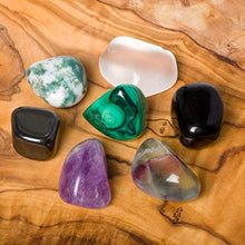 Load image into Gallery viewer, Crystals for Protection/EMF - 7 pc Pocket-Sized Crystal Healing Set - Obsidian, Fluorite, Malachite, Hematite, Amethyst, Tree Agate, Clear Quartz + Informational Guide