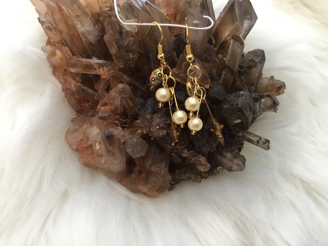 Small gold dangle earring