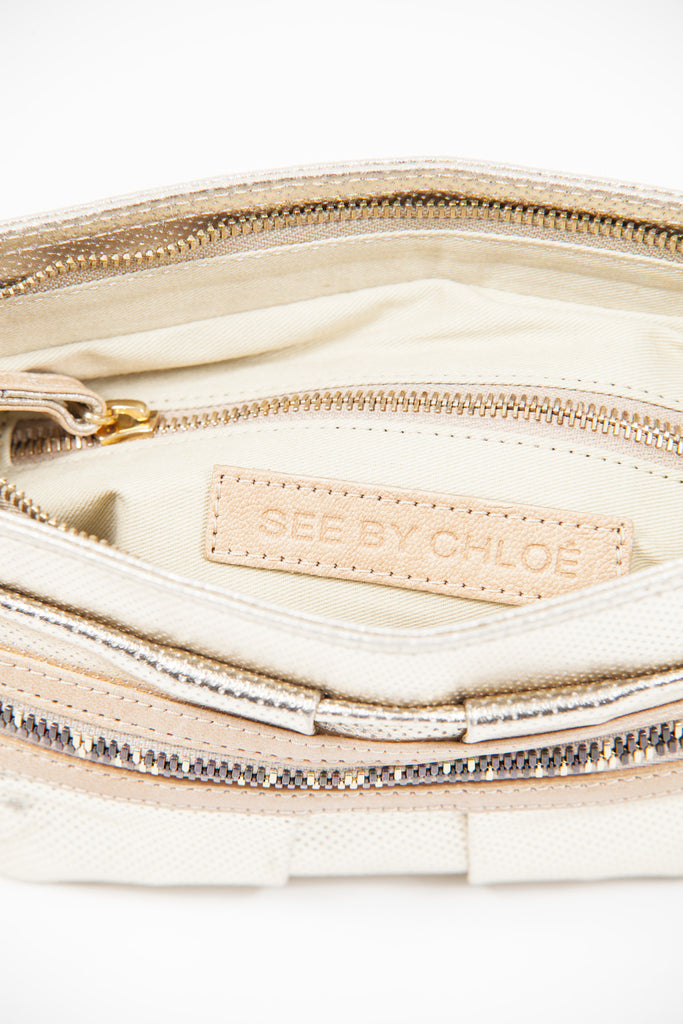 Irregular zip perforated leather clutch by See By Chloe