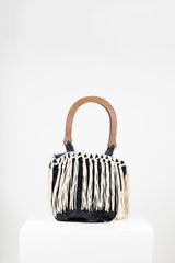 Faux astrakan bag with tassels by Voyage at Isabella's Wardrobe