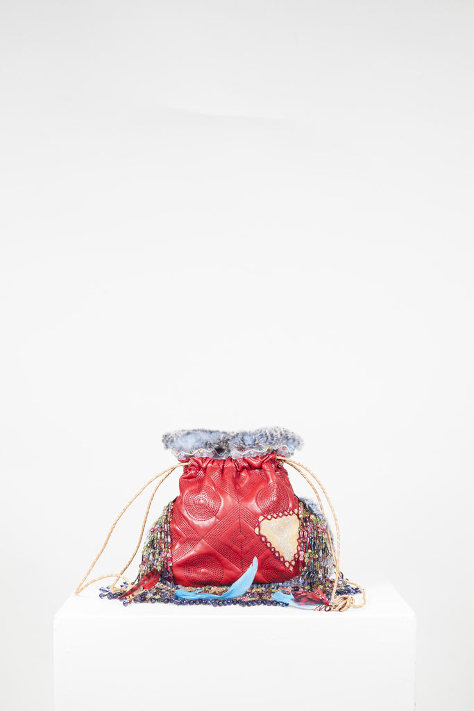 Leather, bead and stud bag with fur trim by Voyage