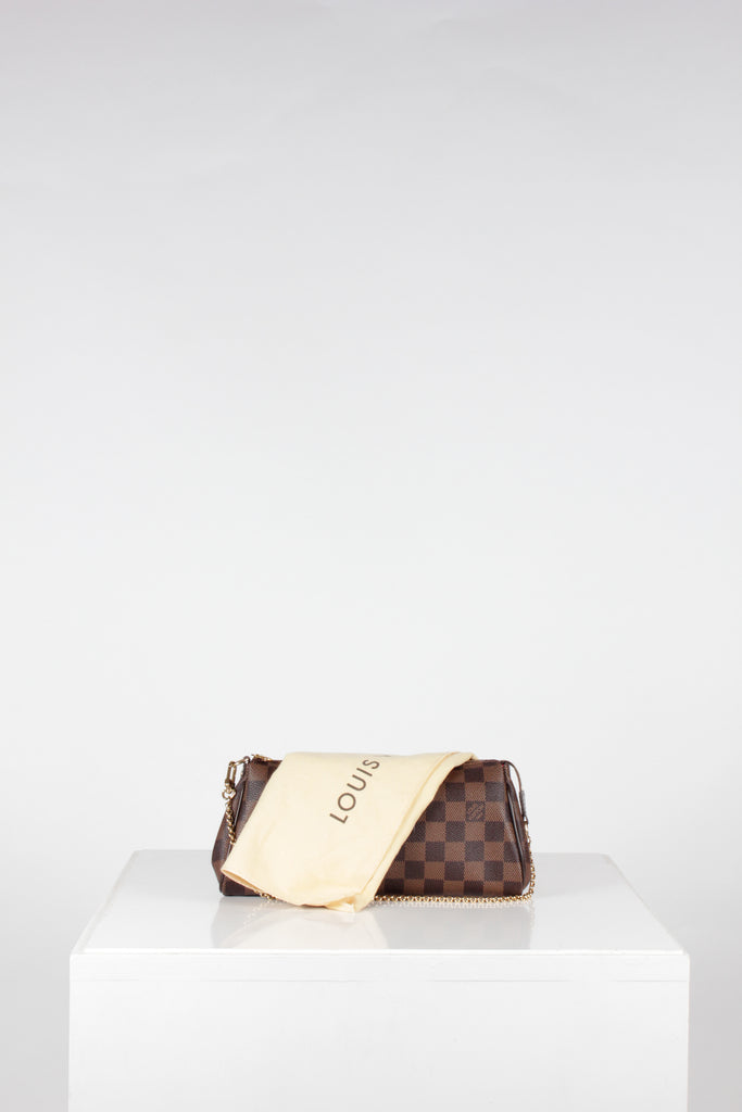 Damier Ebene Eva Clutch by Louis Vuitton