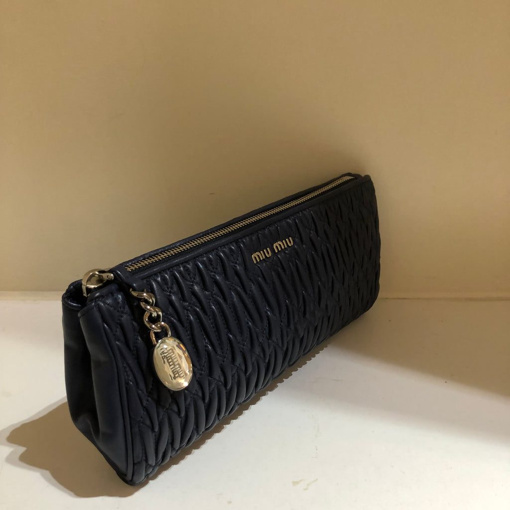 Matelasse Clutch Bag by Miu Miu