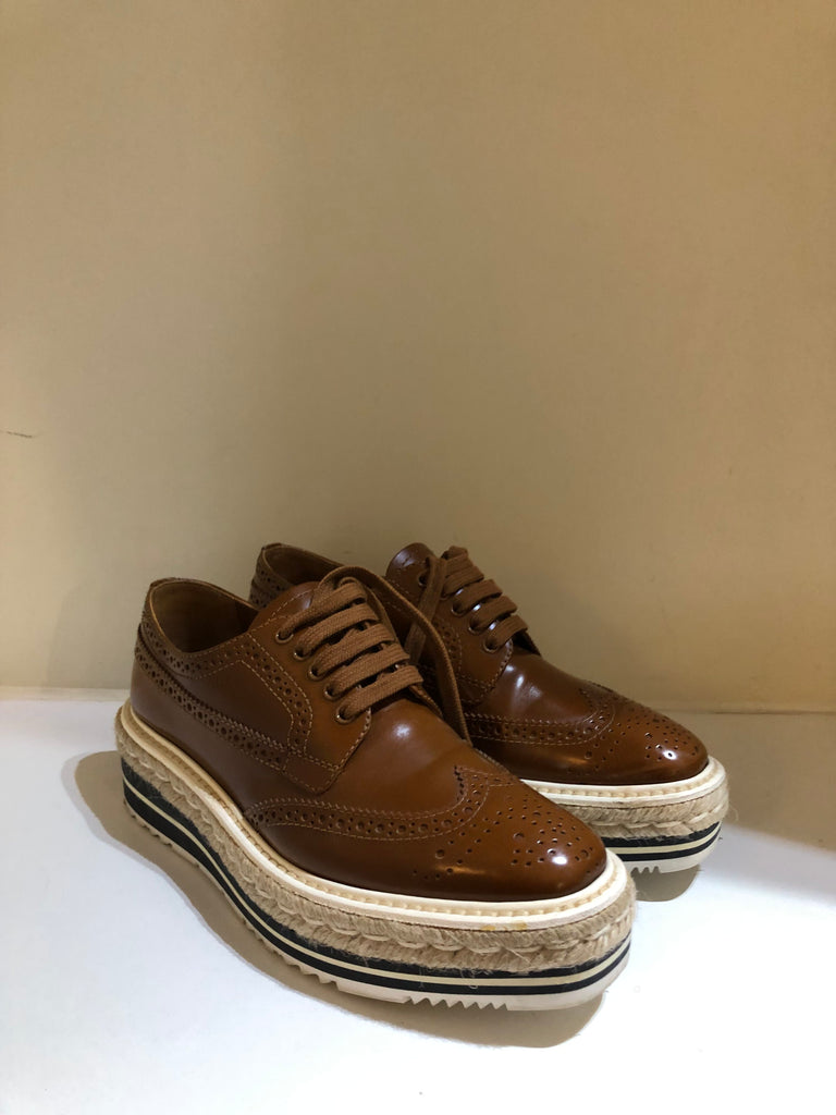 Wingtip Brogue Wedges by Prada