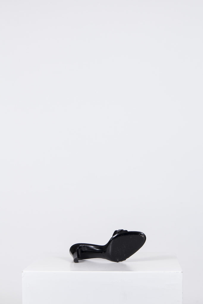 Satin mules with buckle detail by Gucci