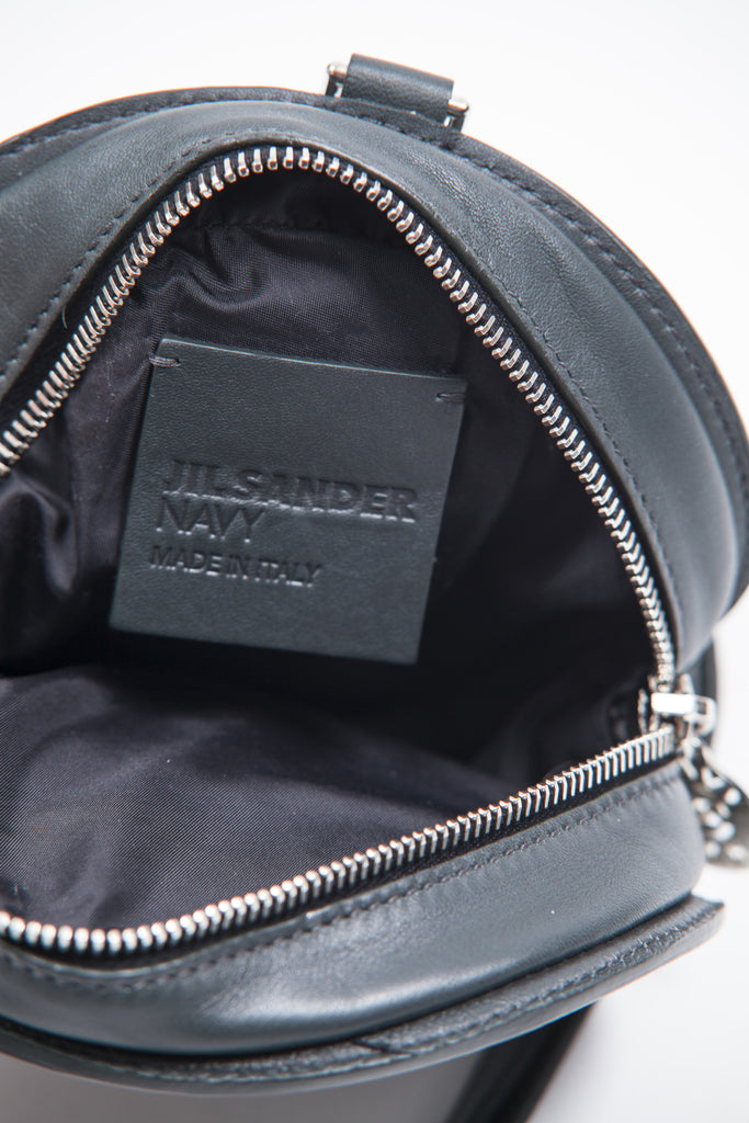 Small circular shoulder bag by Jil Sander