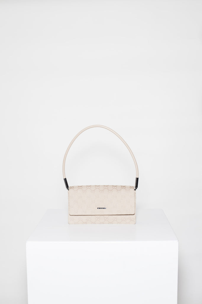 Small monogrammed bag by Gucci
