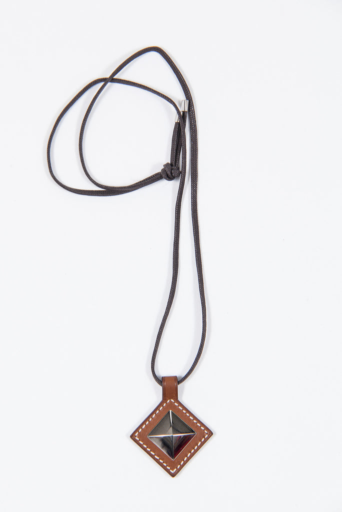 Tuareg leather and palladium necklace by Hermes