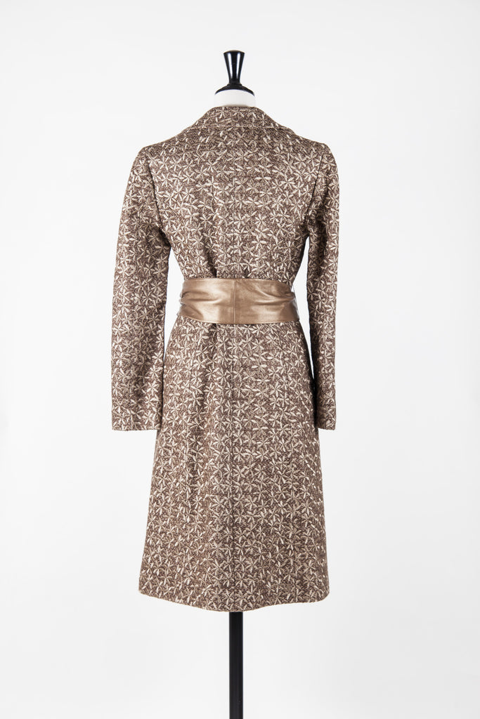 Textured leather belt coat by Vivienne Tam