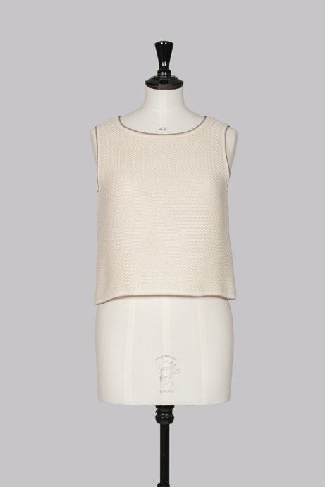 Jacket and sleeveless top by Chanel