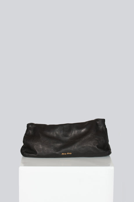 Oversized clutch by Miu Miu