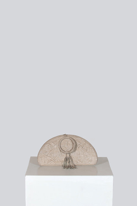 Half-moon evening bag with bangle handle by Shanghai Tang