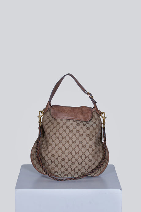 Snaffle-bit logo print bag by Gucci