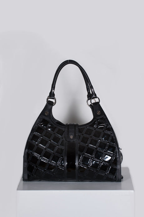 Quilted patent handbag by Versace
