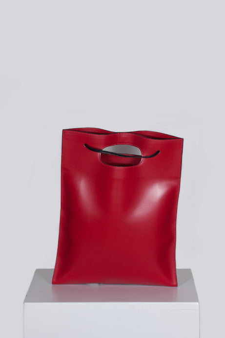 Red handbag/rucksack by Hester Van Eeghen