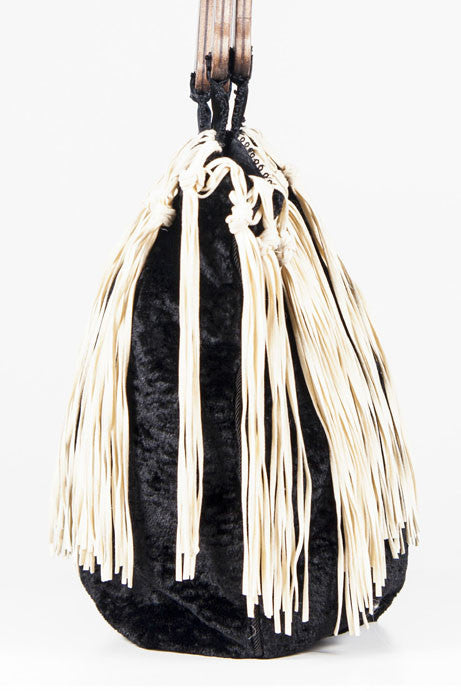Faux astrakan bag with tassels by Voyage
