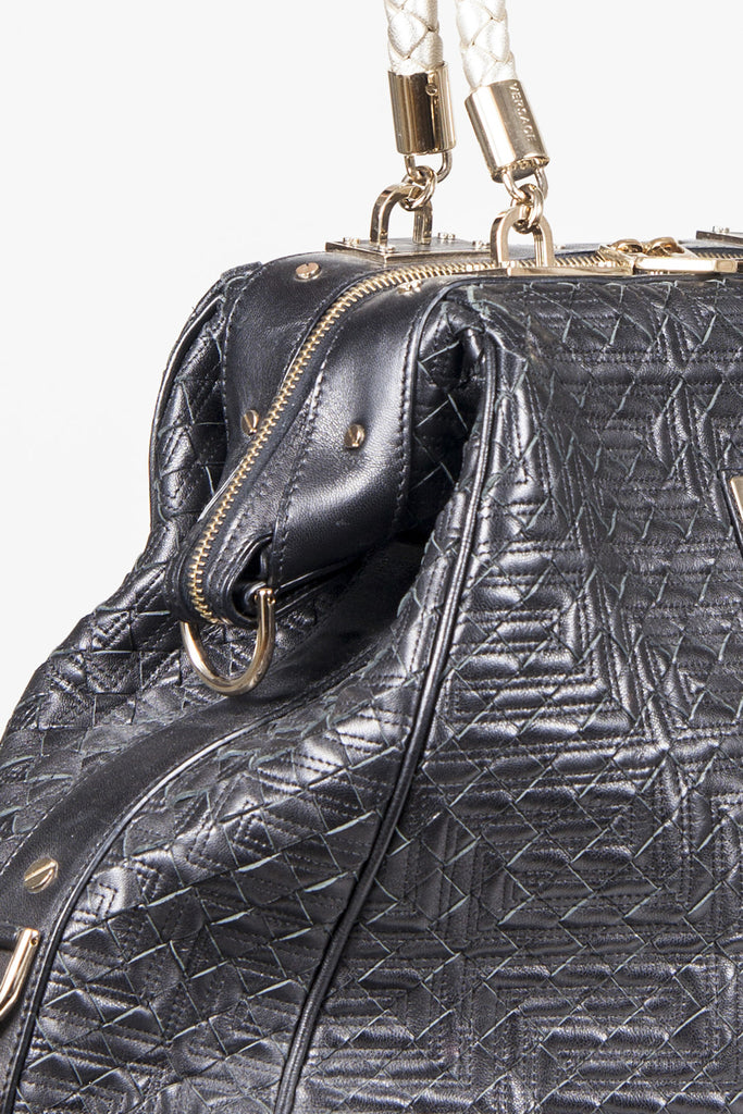 Basketweave leather bag by Gianni Versace