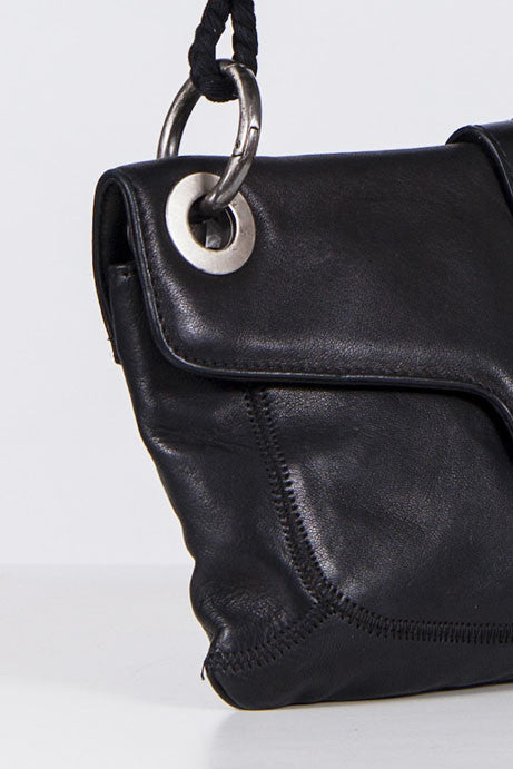 Leather bag with cord and pom pom handle by Lanvin