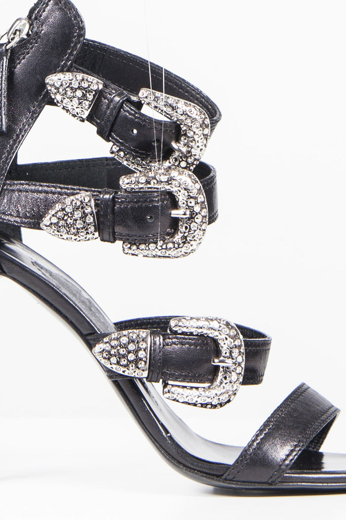 Rhinestone buckle strappy sandals by Guisseppe Zanotti