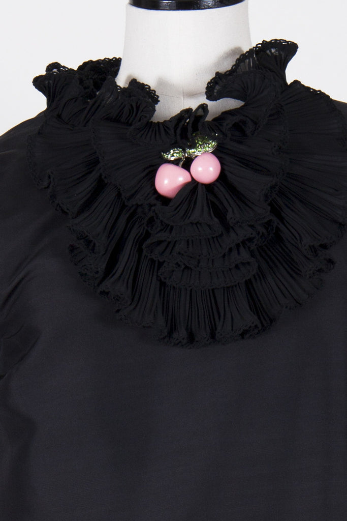 Frill neck top with brooch by Manoush