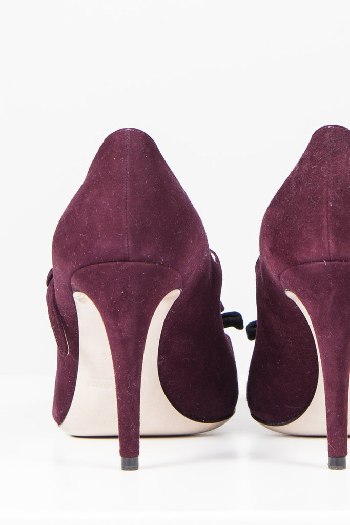Suede heels with bow detail by Miu Miu