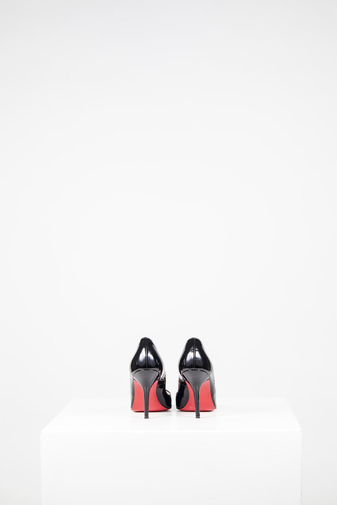 Patent peep-toe heels by Christian Louboutin