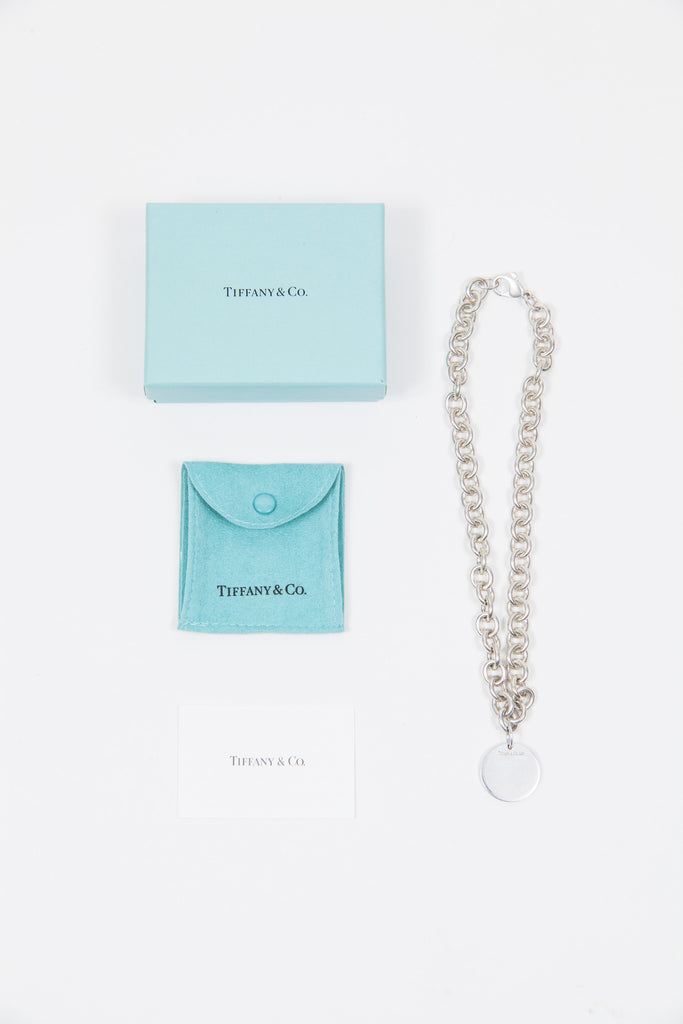 Silver disc necklace by Tiffany