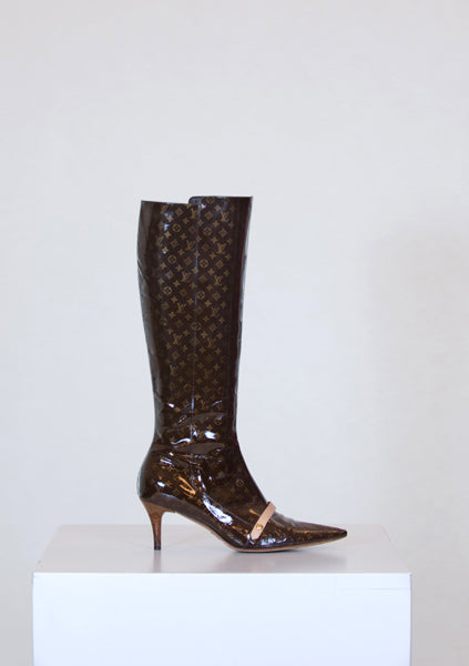 Patent logo boots by Louis Vuitton
