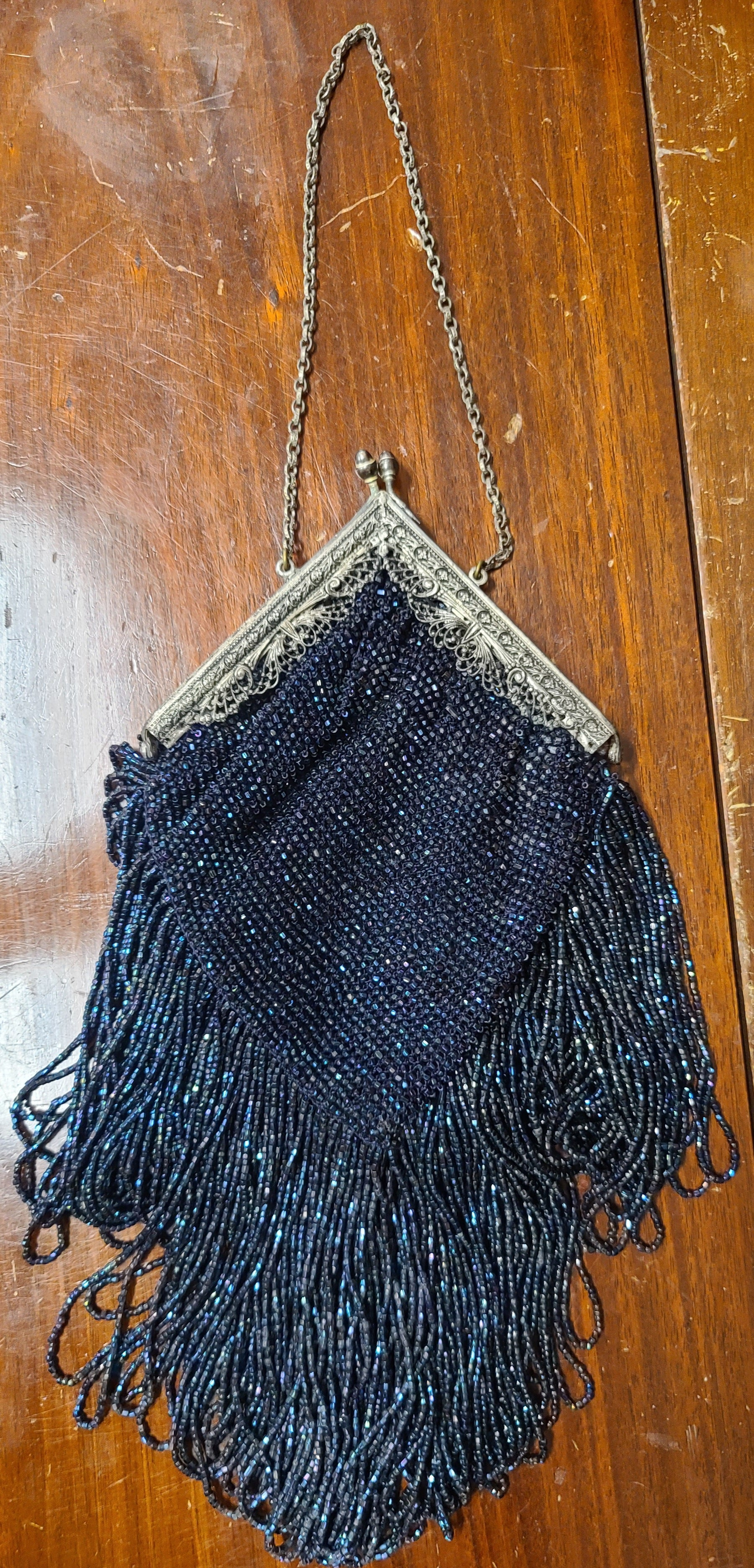 Vintage indigo beaded evening purse with tassels and wrought silver